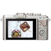 A picture of Olympus PEN E-PL8 Mirrorless Camera in White with 14-42mm EZ Lens Blogger Kit
